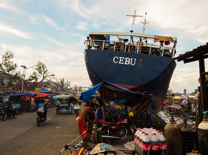 In Tacloban, a number of large ships were washed ashore by the typhoon. The survivors used the generators on some of these boats to supply them with electricity. Photo credit: Timo Luege
